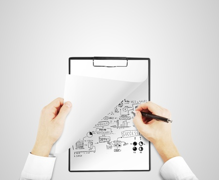 hands holding notepad and drawing global concept Stock Photo - 16698528