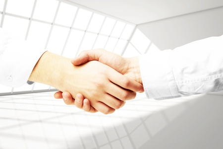 handshake on a white  room background photo