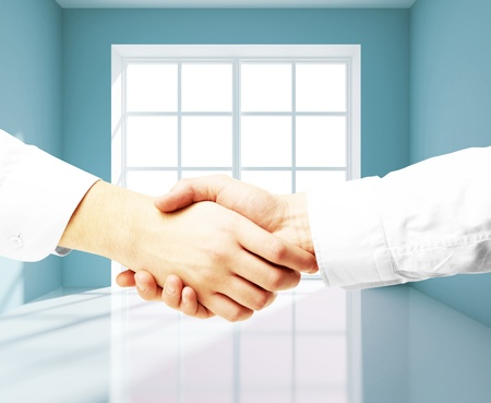 handshake on a blue room background photo