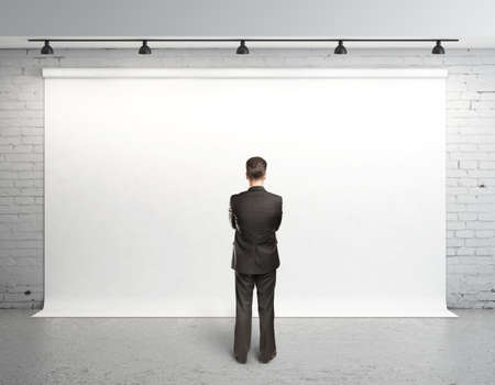 man and white backdrop on wall photo