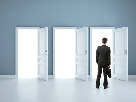 man andf three opened doors Stock Photo - 16698918