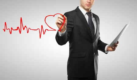 man drawing heart and chart heartbeat photo