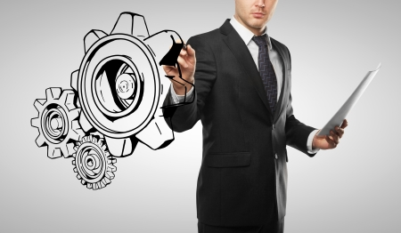 businessman drawing gears on white background photo