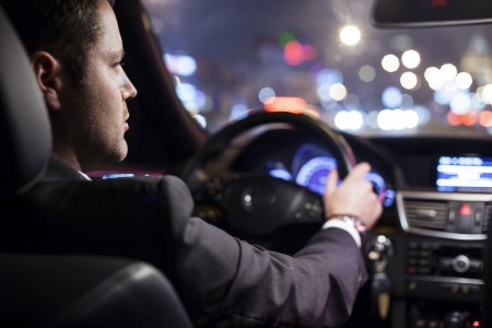 driver: businessman driving a car at night