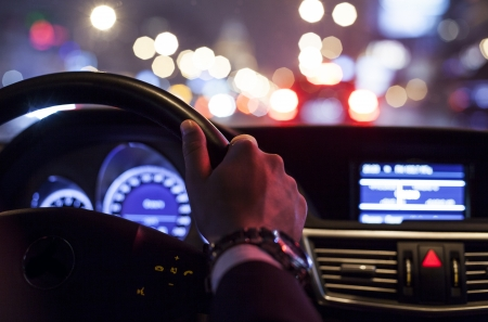 steering: hands on wheel and city nightlife