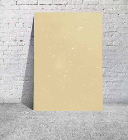 yellow table standing next to a brick wall photo