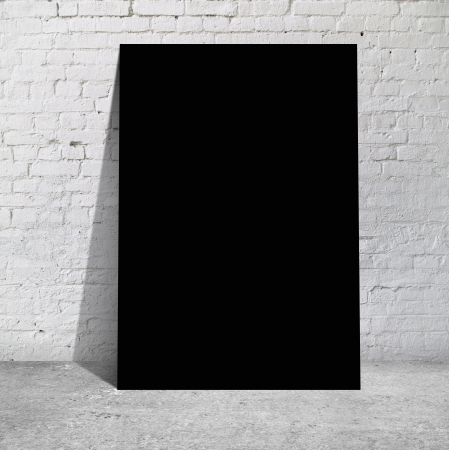 black table standing next to a brick wall photo