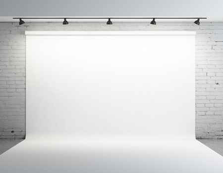 backdrop: White backdrop in room with grey paint on wall Stock Photo