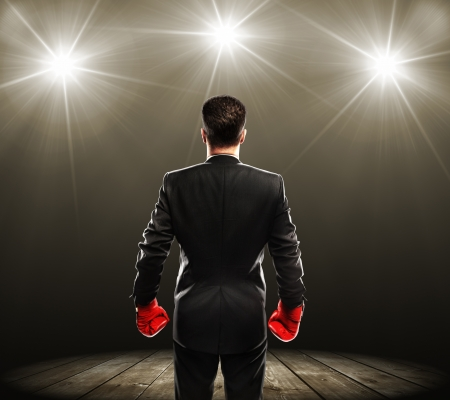 winner man: businessman with boxing gloves, rear view