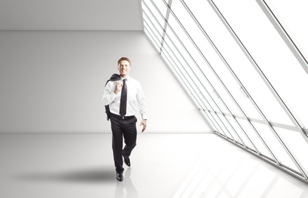 businessman walking in white office Stock Photo - 16700446