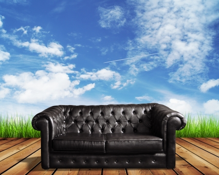 leather sofa on wooden floor and blue sky photo