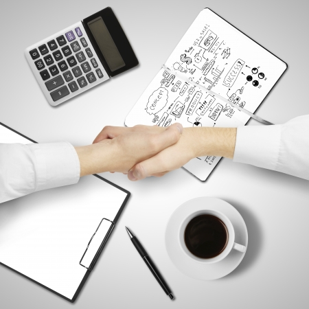 handsshake on business table background photo