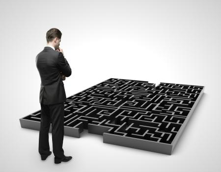 labyrinth: businessman looking at labyrinth