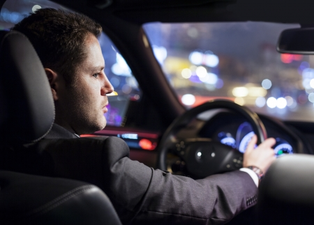businessman driving a car at night Stock Photo - 16701138