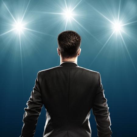 blue spotlight: businessman with suit, rear view