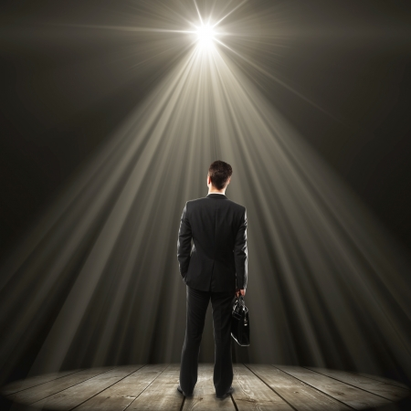 businessman with briefcase and lamp with with rays Stock Photo - 16700604