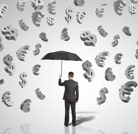 argent: man with umbrella and money symbol Stock Photo