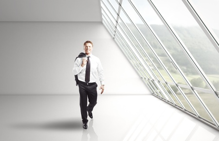 businessman walking in white office Stock Photo - 16720592