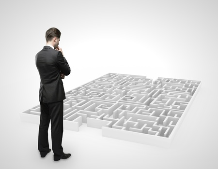 businessman looking at labyrinth on white background Stock Photo - 16720593