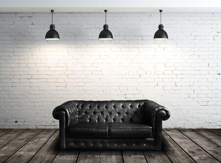 leren bank: leren bank in baksteen kamer en drie lampen