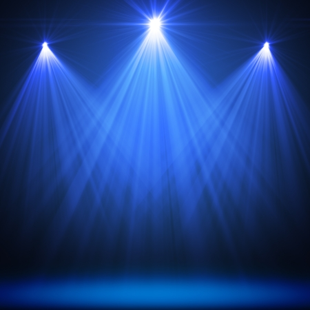 lights on: stage spot lighting over blue christmas textured Stock Photo