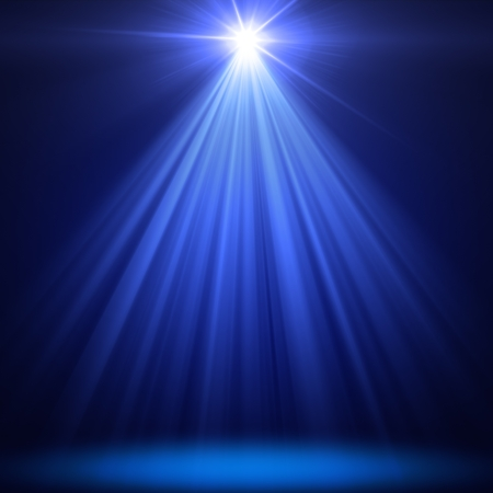 stage spot lighting over blue christmas background Stock Photo