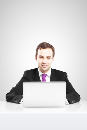 Businessman with laptop on a white background Stock Photo - 16763781