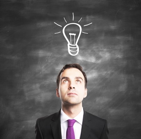 businessman with lamp, idea concept Stock Photo - 16763797