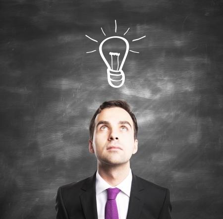 businessman with lamp, idea concept Stock Photo - 16763797