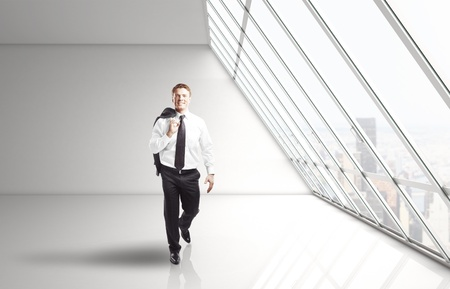 businessman walking in white office Stock Photo - 16852123