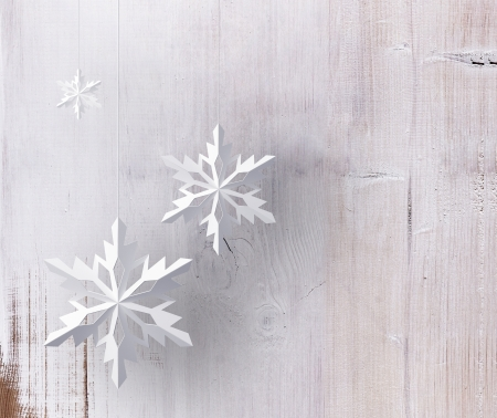 three decorative snowflakes on wood background Stock Photo