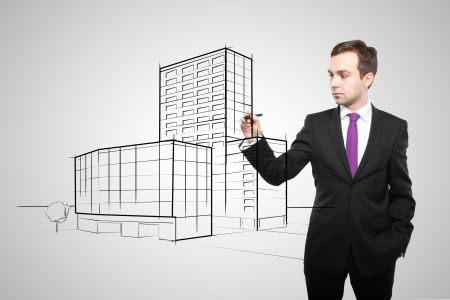 man drawing skyscraper on white background photo