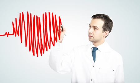 doctor drawing chart heartbeat and heart photo