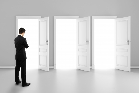 businessman and three opened doors Stock Photo - 16883195