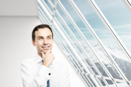 businessman thinking in white loft office Stock Photo - 16883292