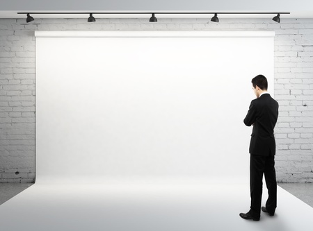 man and blank backdrop in room Stock Photo - 16883197