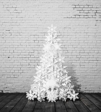 paper christmass tree and brick interior photo