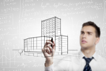 man drawing skyscraper on formulas background photo