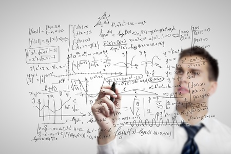 businessman drawing mathematical formulas on a board Stock Photo - 16985865