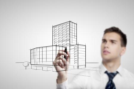 disegni a matita: uomo d'affari grattacielo disegno su sfondo bianco