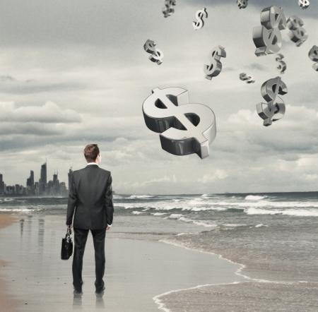 businessman standing: Businessman standing on a beach and  dollar symbol
