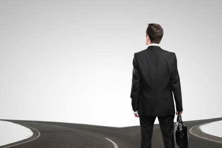 businessman standing at a crossroads Stock Photo - 16985856