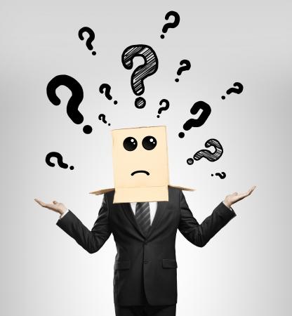 shyness: businessman choosing with box in head