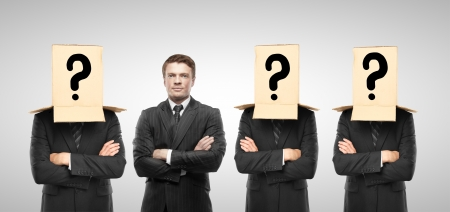 reproach: four man with box on hand, business concept Stock Photo