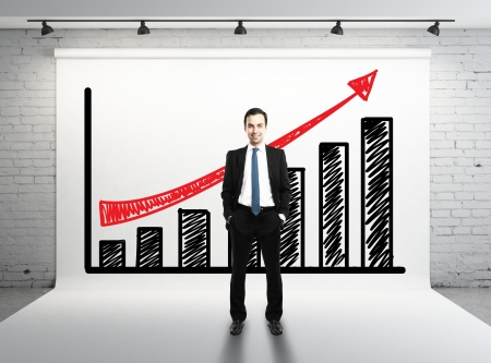 man and succes graph on white backdrop
