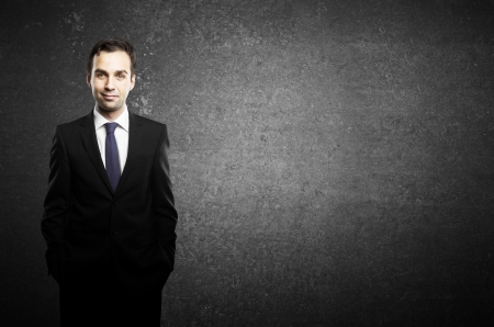 businessman standing and black concrete background Stock Photo - 16985832
