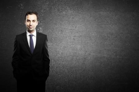 businessman standing: businessman standing and black concrete background