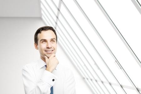 businessman thinking in white loft office Stock Photo - 16985833
