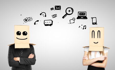 man and woman with smiling box on head, social media concept photo