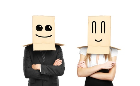 reproach: businessman and woman with smiling box on head Stock Photo